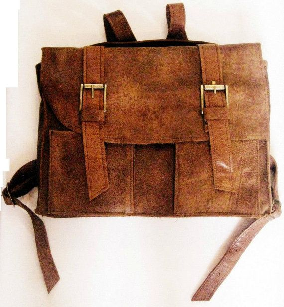 15.6 Laptop Leather Backpack,with two stripes, two buckles and adjustable strap.  Gender: Male/ Female/ Unisex Made of Genuine leather, Handmade.