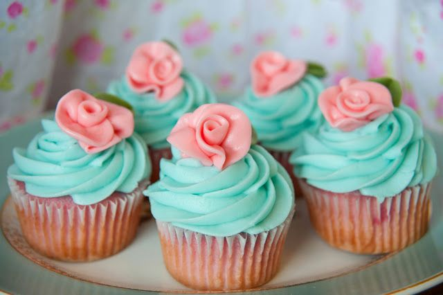 Hmmm...Strawberry cupcakes with turquoise cream cheese icing?  Replace the flowers with little birdies for a Burlap and Birdies 1st Birthday. :)