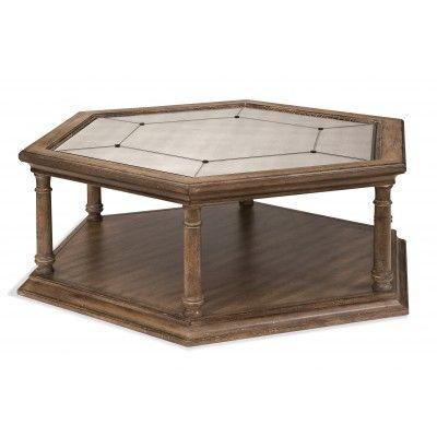 Оригинальный журнальный столик с необычной шестиугольной столешницей. Столик изготовлен из массива дерева.             Метки: Журнальный стол.              Материал: Дерево.              Бренд: Bassett Mirror.              Стили: Классика и неоклассика, Прованс и кантри.              Цвета: Коричневый.