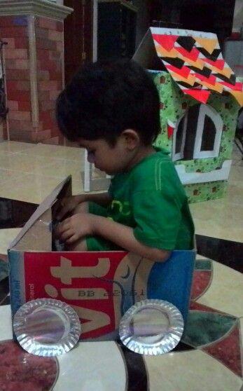 Playing a cardboard car #cardboard #kids #toy #diy