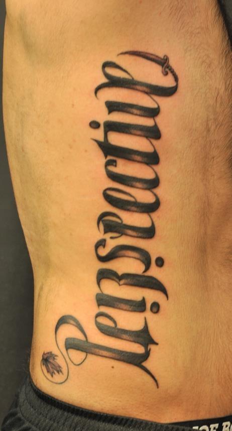 Chronic ink tattoos toronto tattoo ribs ambigram by for Tattoo writing on ribs