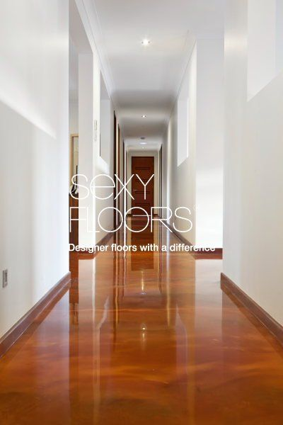epoxy resin floor, by Sexyfloors.  Perfect for a different look in the garage.