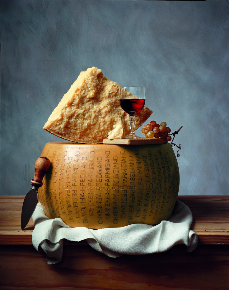Parmigiano Reggiano cheese with red wine and grapes