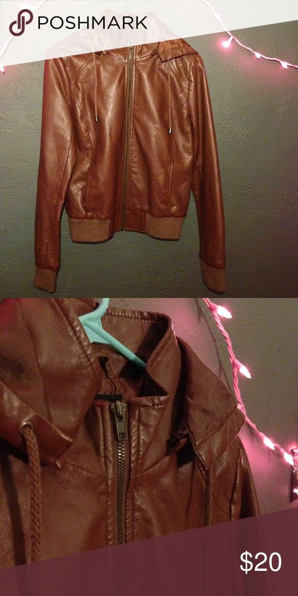 🌸F21🌸 Leather Bomber Jacket This brown, faux-leather, hooded bomber jacket with drawstrings is from FOREVER 21. Looks really good with a scarf. Great condition. Size medium but fits small! Forever 21 Jackets & Coats