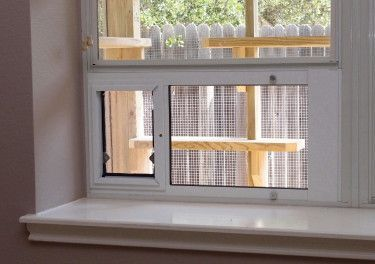 The Cat Carpenter Catios - There are several types and sizes of high quality window inserts that make it easy to add a cat door.