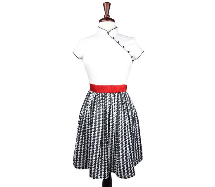 Chinese meets Scottish in this simple yet striking modern qipao that blends an elegant white top with a flowy houndstooth skirt and red sash flawlessly.
