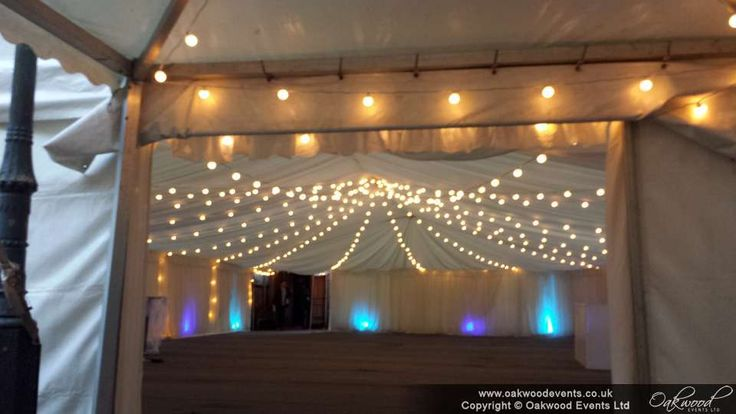 Marquee festoon lighting and uplighting for a themed ball at the OU
