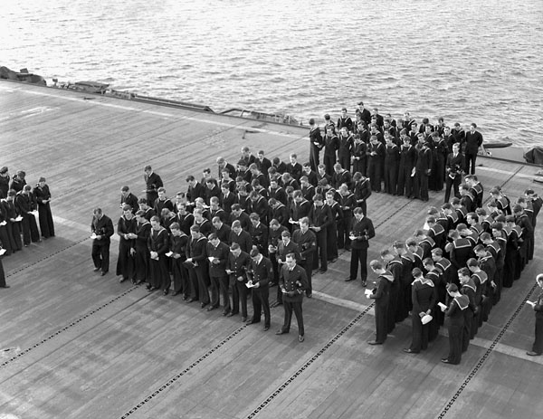 Lest We Forget. Divisions on the flight deck of the Canadian-manned aircraft carrier H.M.S. NABOB, Vancouver, British Columbia, Canada, January 1944.