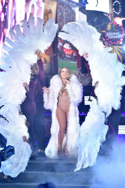 Mariah Carey Photos Photos - Mariah Carey performs onstage during New Year's Eve 2017 in Times Square at Times Square on December 31, 2016 in New York City. - New Year's Eve 2017 In Times Square