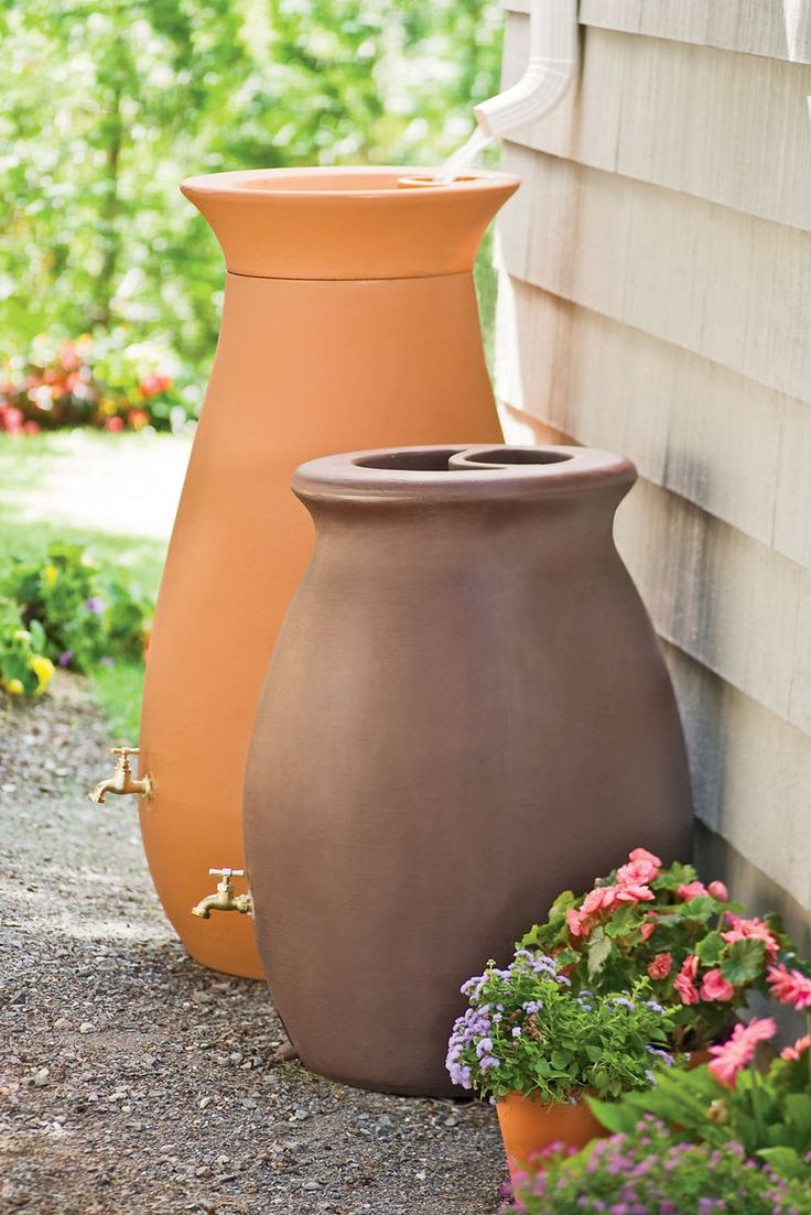 Rain Water Barrels - Urn Shaped. 65-gallon and 50-gallon. There's a rain barrel for you at gardeners.com