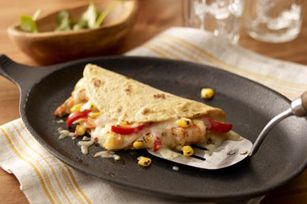 Chile-Lime Shrimp Quesadillas     1lb.  frozen cooked cleaned medium shrimp, thawed1/4cup  chopped fresh cilantro1/4cup  lime juice1/2tsp.  garlic powder1tsp.  chili powder1cup  frozen corn, thawed1 red pepper, cut into thin strips8 flour tortillas (6 inch)1pkg.  (8 oz.) KRAFT Shredded Pepper Jack Cheese with a TOUCH OF PHILADELPHIA