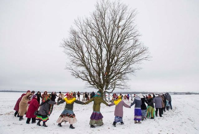 Villagers take part in Kolyada holiday celebrations in the village of Martsiyanauka, east of the capital Minsk, January 21, 2015. Local residents took part in the celebrations to mark the end of a pagan winter holiday Kolyada.  Kolyada is an ancient pre-Christian winter ritual/festival,probably named after Kolyada, the Slavic god of winter or Koliada, the goddess who brings up a new sun every day.  (Photo by Vasily Fedosenko/Reuters)