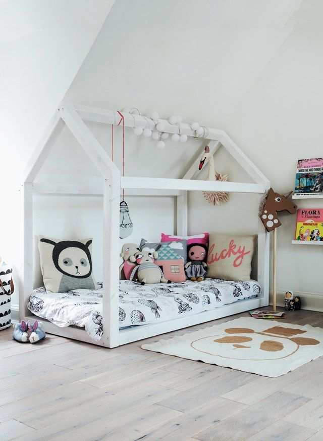 This custom-made wood-frame bed can be transformed into a playhouse during the day.