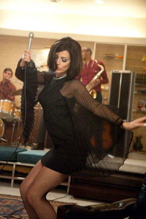 Megan Draper sways in her exquisite sheer-sleeve dress and #fishnet tights #MadMen