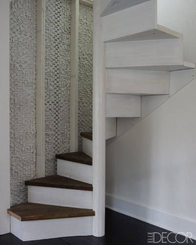 With a Light Touch  A staircase crafted of reclaimed wood leads to the attic, which houses Morey's office and a guest bedroom #DIYAtticRemodel
