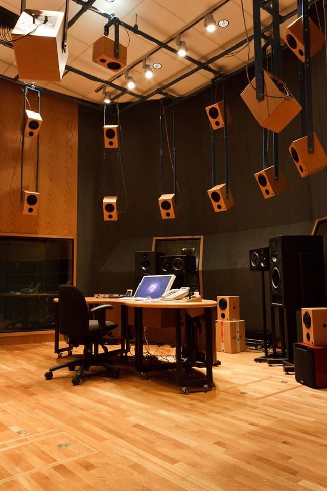 This is a studio setup with several monitors. It contains the following quality of play: Freedom From Time. If I was in this room I would forget what the outside looked like. It contains the artist/creator and kinestethe personalities of play. I could create all kinds of new awesome sounds. As a musician music is a craft that's felt not an equation that's solved. This is also my future play.