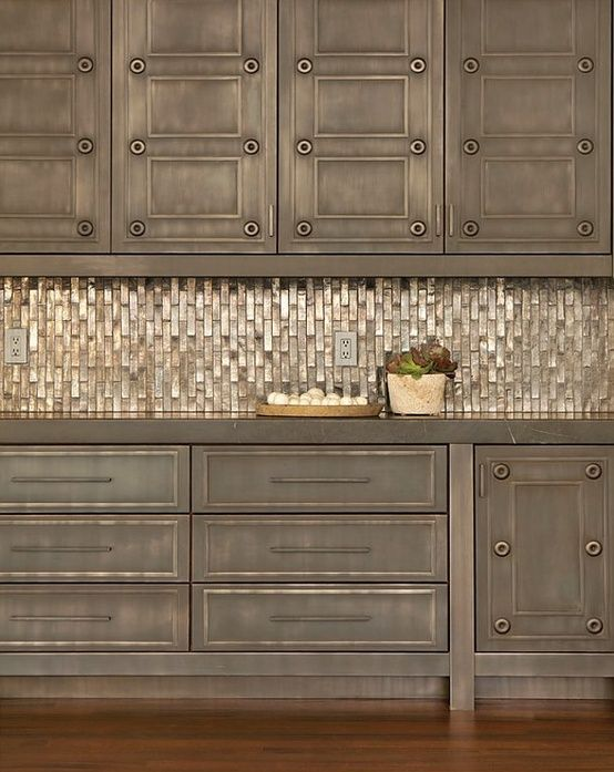 Distressed Cabinets With An Amazing Metallic Backsplash