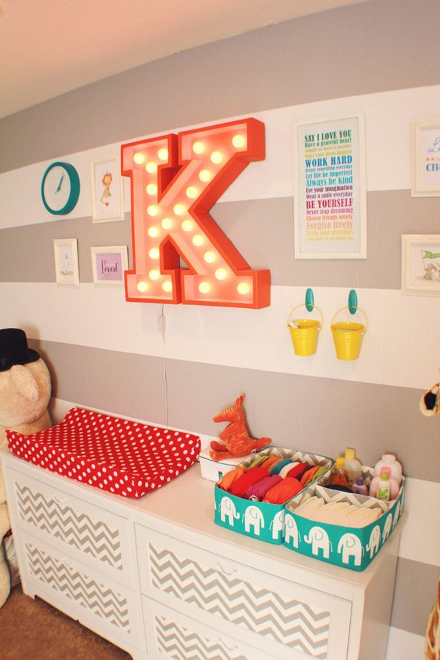 I like the letter for a circus themed playroom and the gray and white walls