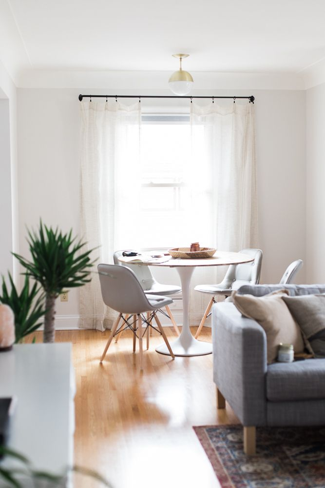 Pinterest: tobieornottobie round kitchen table with gray trendy chairs, wood floors, dark gray couch and plants