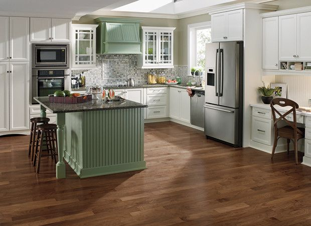 white kitchen cabinets with gray countertops and wood floors