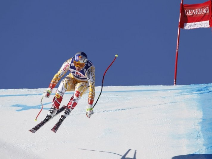 Canadian Olympian Erik Guay : Winning gold again , making him the winningest downhill skier in Canadian history with Steve Podborsky