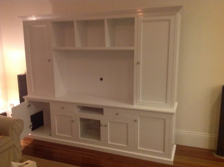 Detail: showing sub-woofer, centre speaker, television compartments. Paint: Dulux white on white satin finish.