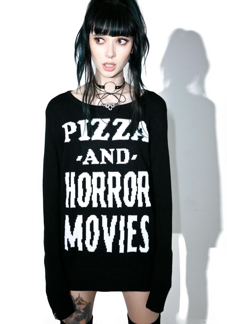 Killstar Stayin' In Knit Sweater ...let's just light sum incense and get this night goin'! Lounge around in this mega comfy sweater, featurin' a black knit construction, slouchy fit, wide rounded neckline, and big white lettering across the chest reading 'Pizza And Horror Movies.'