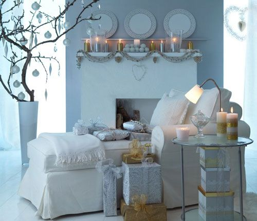 Christmas branch decor candles chaise   http://www.apartmenttherapy.com/the-modern-minimalists-christm-37967