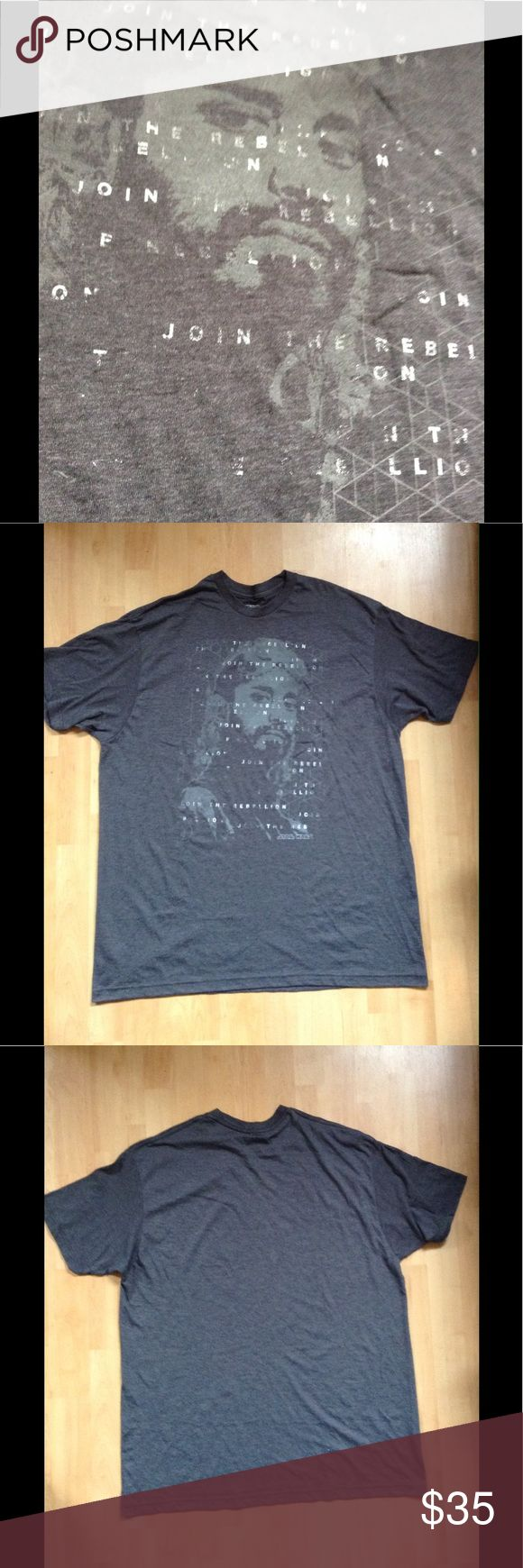 """STAR WARS JOIN THE REBELLION TEE Dark Gray XL A new & unworn tee in a cool dark charcoal gray with understated graphics. In perfect condition. Not sure if it's a boy's XL or if it's men's sizing, but the chest (unstretched) measures around 50-52"""". Athletic fit. Save an additional 10% automatically by bundling w/2 or more items from my closet. Plus, I ship fast! Star Wars Shirts Tees - Short Sleeve"""