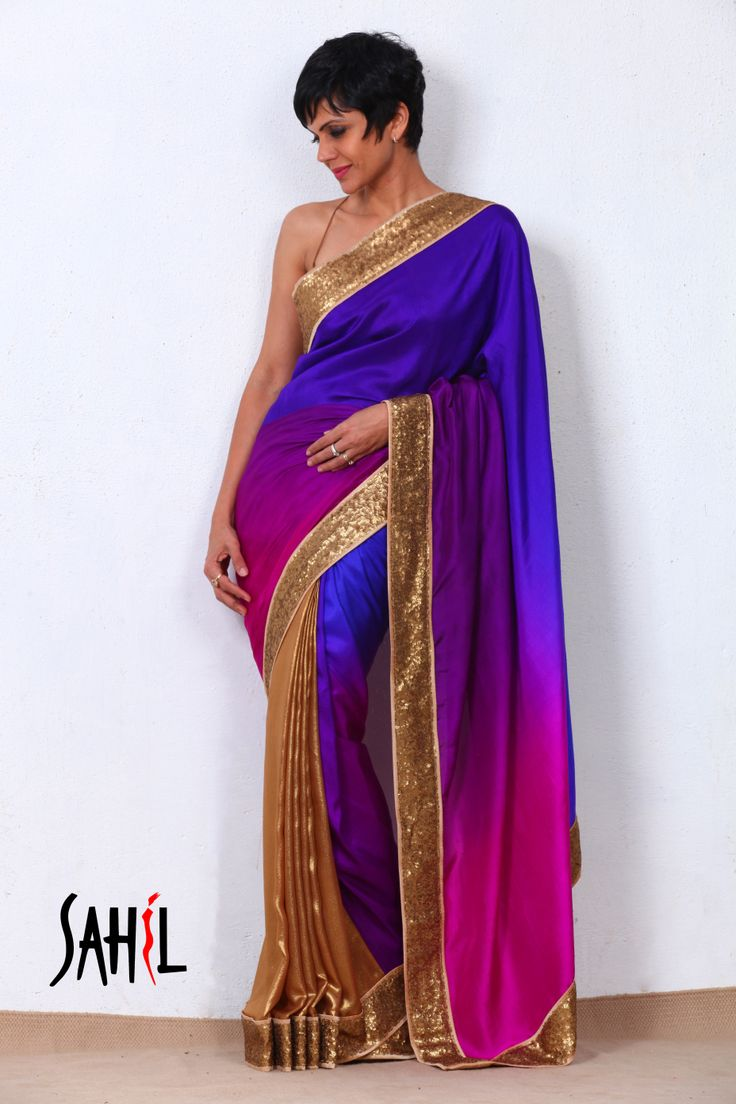 Golden and purple shaded art georgette and dupion silk saree featuring a golden sheet sequined border with beige backing and piping. The saree comes with an unstitched blouse piece.