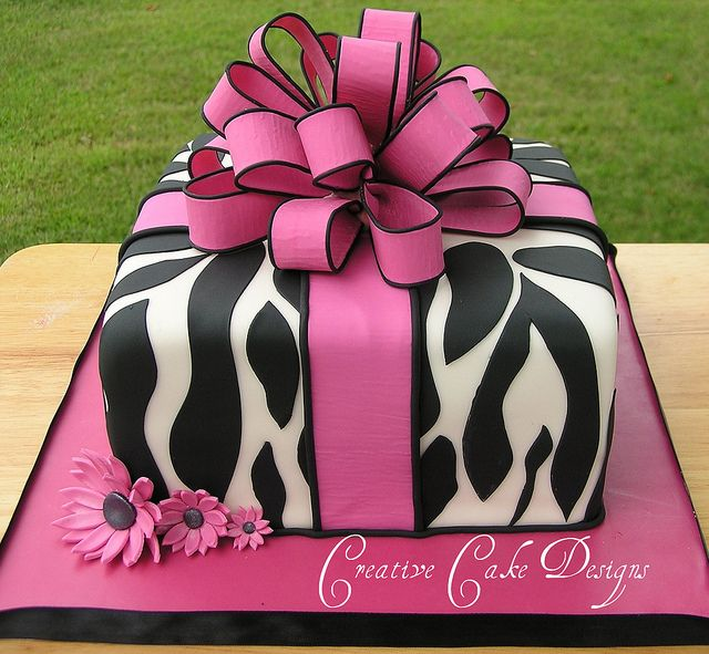 shower cake! EVERYTHING I LOVE.....pink, zebra, and daisies:)
