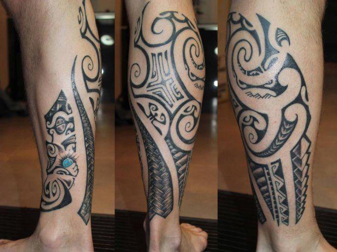 Maori tattoo of man calf with tiki and polynesian big waves by ta a tiki tattoo marseille - Tatouage maorie signification ...