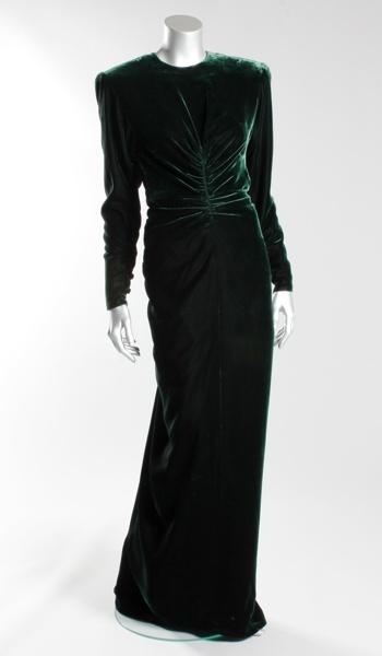 """VICTOR EDELSTEIN EVENING GOWN-Forties-inspired with """"Dynasty""""-style padded shoulders, this bottle-green velvet Victor Edelstein gown made in 1985 was worn only for private entertaining, so there are no public photographs of Diana wearing it. """"The dress has what looks like a tiny handprint on the skirt, which could have easily been dry-cleaned out, but it's part of the charm,"""" Taylor reveals. """"The suspicion is that it could have been a little prince saying: 'Don't go out,"""