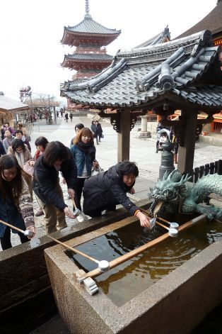 Visitors to the Kiyomizu-dera Buddhist temple in Kyoto sip sacred water from a spring fountain that is supposed to bring good fortune. Photo...
