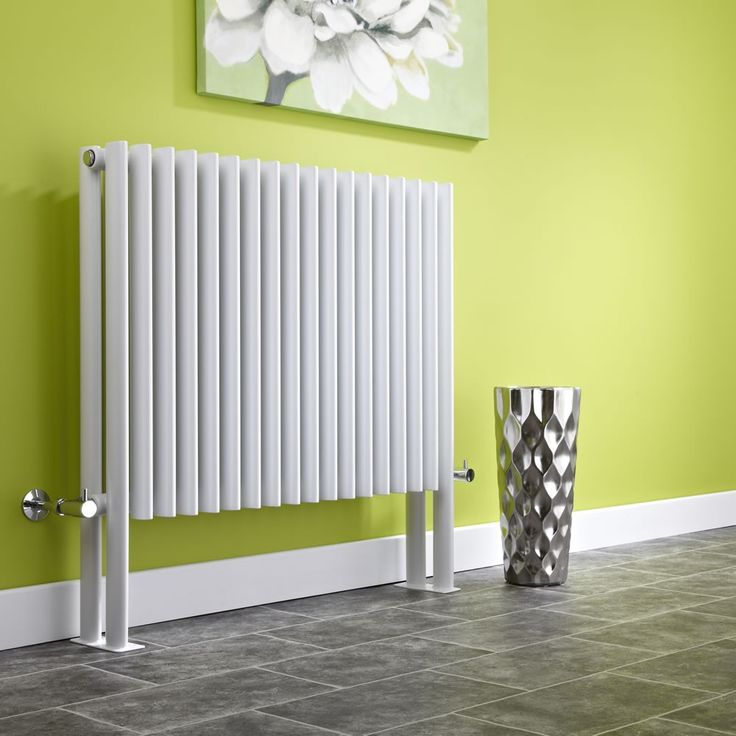 We love the contrast of this white designer radiator against the lime green decor.