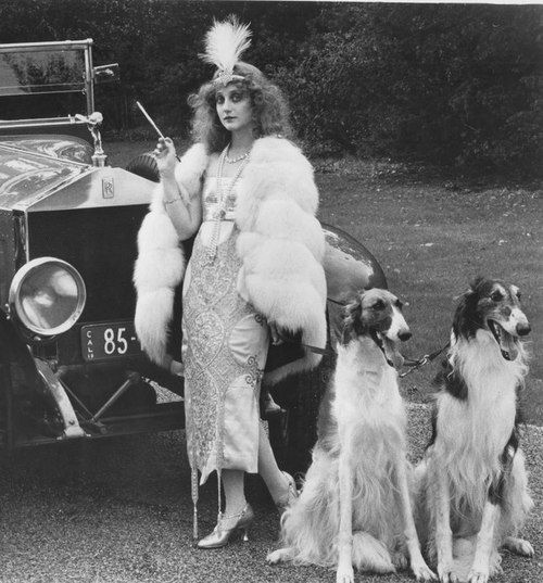 """Carol Kane and two pedigree Borzois ( Russian Wolfhound) in """"Valentino"""", 1977. Directed by Ken Russell. °"""