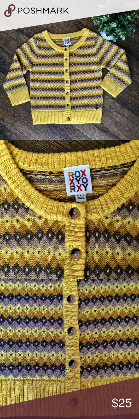"""Colorful Roxy cardigan sweater with 3/4 sleeves Roxy cardigan style sweater with 3/4 sleeves. Beautiful colors and pattern. Perfect for fall with jeans and brown boots.  70% acrylic and 30% wool. Measurements: armpit to armpit ~16.75"""", top of shoulder to bottom of sweater ~ 19"""", length of sleeve ~17.25"""". Roxy Sweaters Cardigans"""
