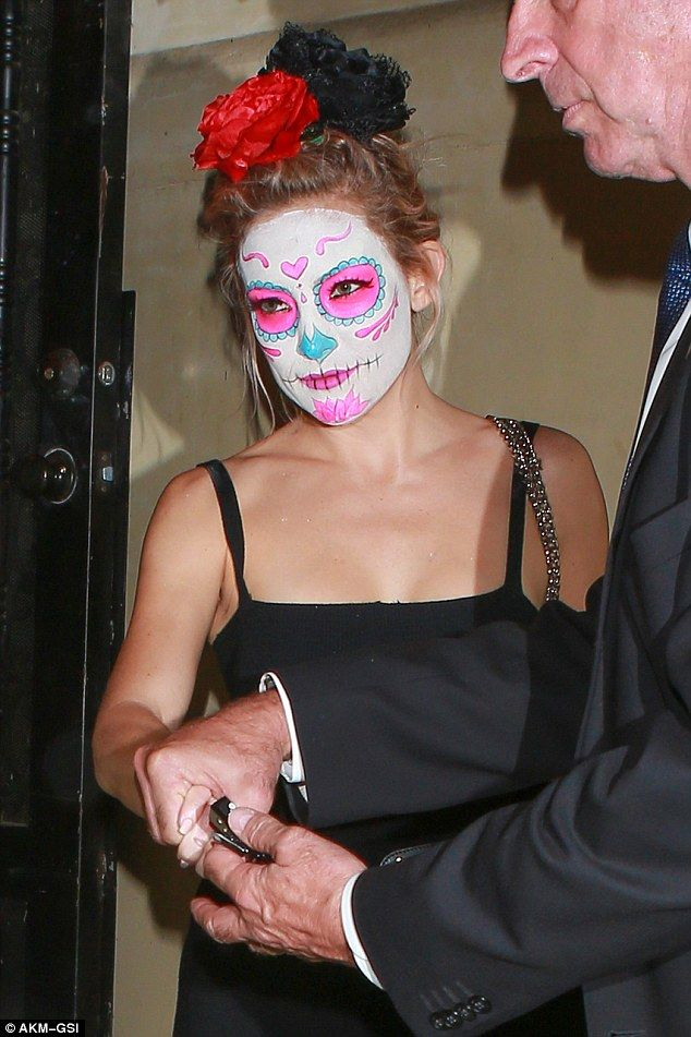 Let's face it... The actress chose to obscure her features under a Mexican death mask for ...
