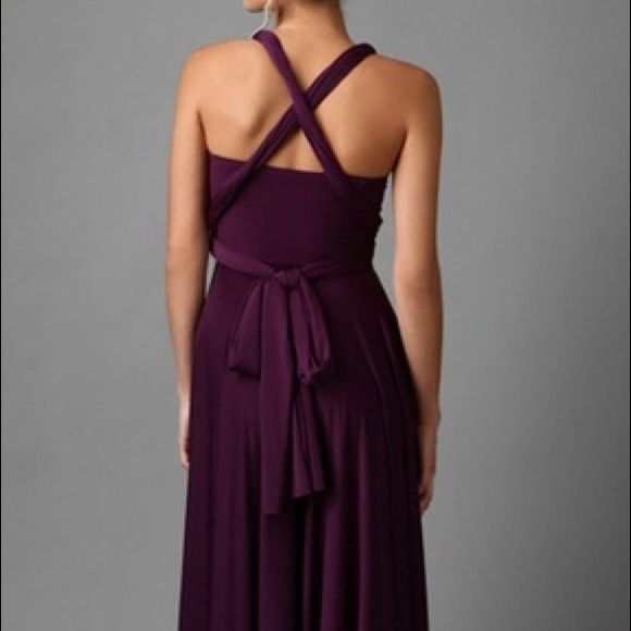 """Two Birds dress Two Birds dress in aubergine. Marketed as being a bridesmaid dress, but can be worn for any appropriate occasion. This is a wrap dress that can be made into various styles. One size fits all. Please google """"two birds."""" Worn once for 2 hours. Excellent condition. Two Birds Dresses Wedding"""