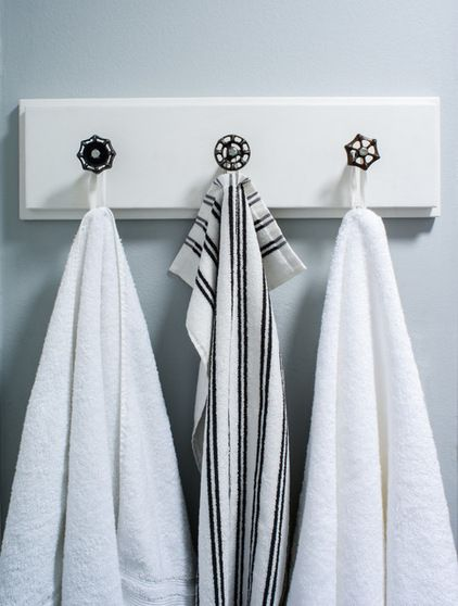 antique faucet handles from the flea market installed on a board to make this towel rack. (Transitional Bathroom by christie hausmann design)