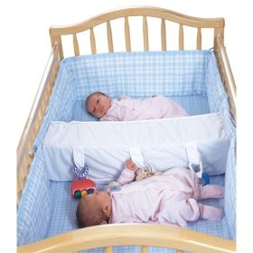 Crib spacer for twin no more boots to the head...if i ever need this:O