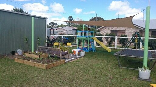 Play and sitting area for under 900 dollars. We have a fort, sand pit, swings and trampoline all covered with shadecloth. With herb garden and native garden.