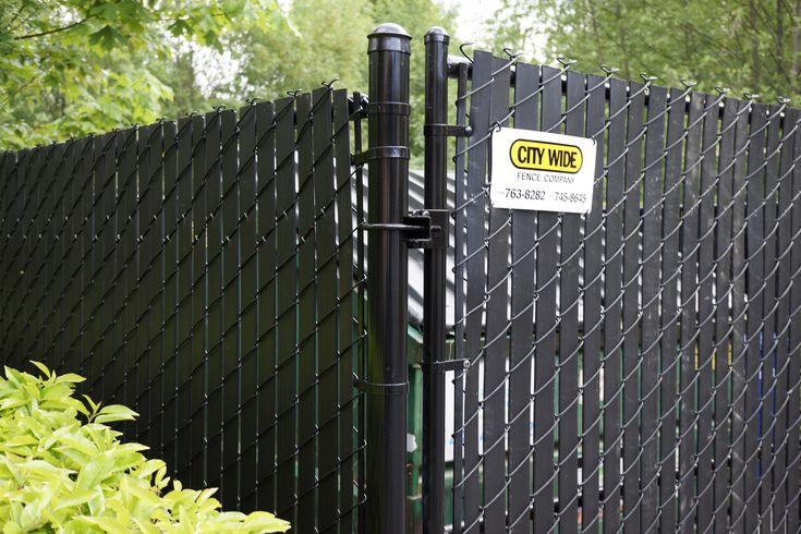 Chainlink Fence around Garbage Dumpsters