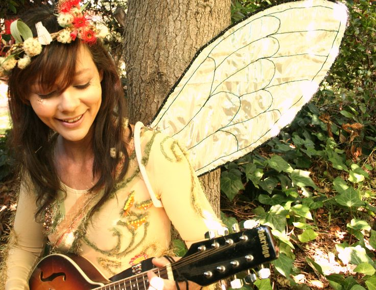 Wildwood loves strumming a fae tune on her mandolin. Beautiful costume by Nerida lee Groom. www.willywagtails.com