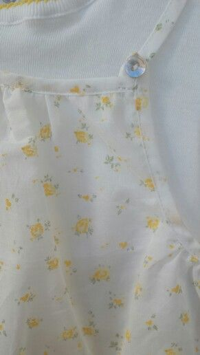 Detalle body vestido de Laranjinha, disponible en www.livingbaby.es