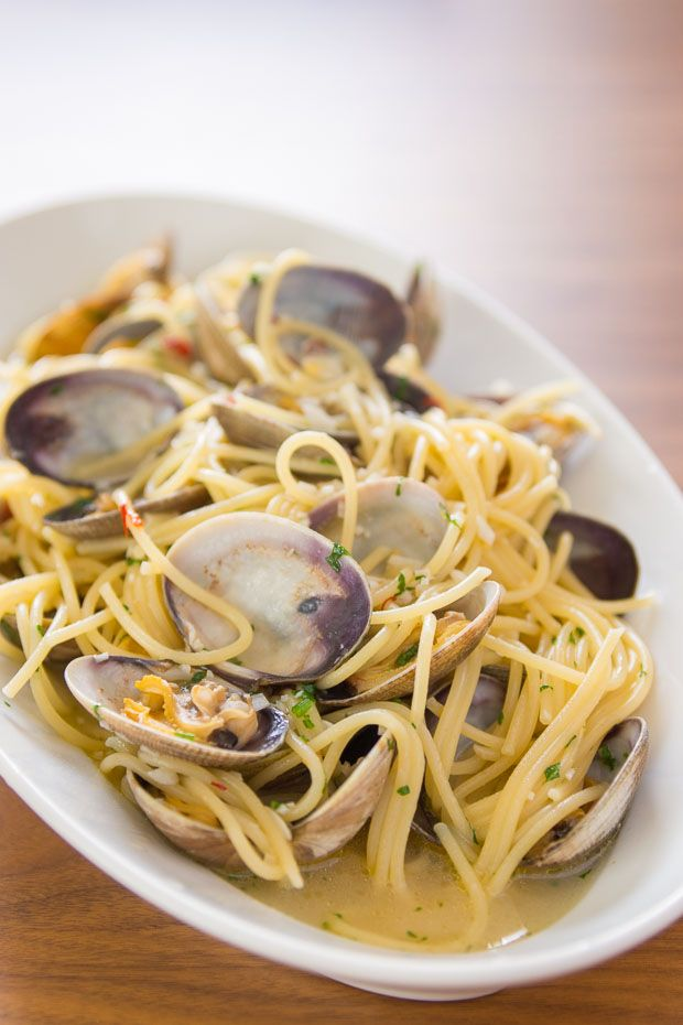 Spaghetti Alle Vongole. (spaghetti with clams). This simple six ingredient clam pasta is easy to make and yet incredibly tasty. Manila clams are very small clams & tasty.