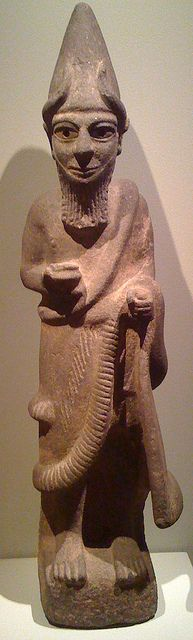A Hittite Priest-King (or Deity), around 1600 BC. This large basalt sculpture, with bone eyes, is rare in depicting a Hittite priest-king wearing a horned conical crown, false beard, and long robe. He holds a bowl in his right hand and once held something in his left, perhaps a staff or sword. Anatolia It is now in Cleveland Museum of Art, University Circle, Cleveland, Ohio.
