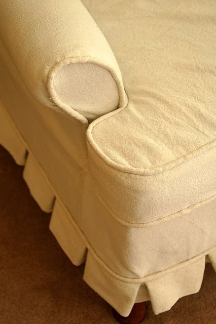 make a slipcover with a dropcloth - inexpensive and will cover darker fabrics better than twill