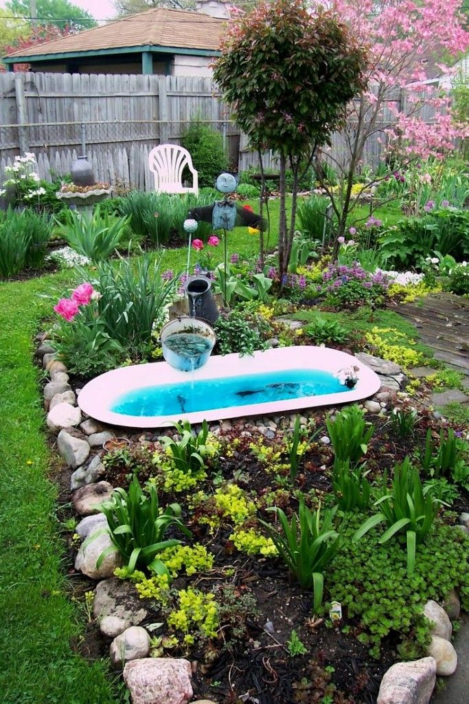 Small garden fishpond from a repurposed bathtub
