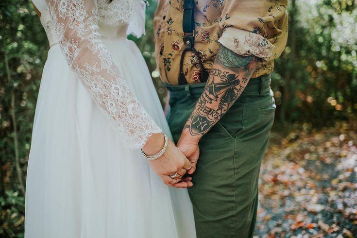 Real Wedding: Cait & Zach — Elle & Jae  boho bride and groom, tattoo groom, hand holding photo, fall wedding inspiration, boho bride, BHLDN Bride, Carol Hannah dress, Elle & Jae top, Ithaca wedding, suspenders, rustic, forest wedding